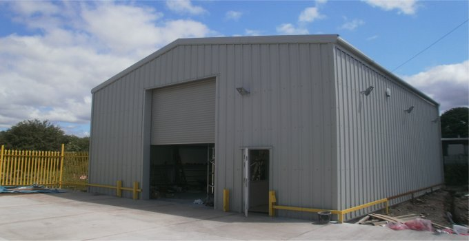 Building used as an industrial unit with steel roller door and side access