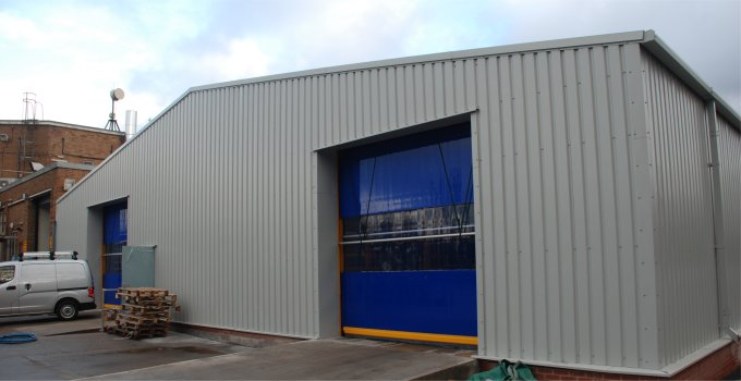Steel building MOT workshop with roller doors