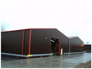 Warehouse unit from a steel shed in brown and red cladding