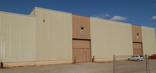 Industrial steel building units on an industrial estate including roller doors