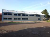 Double height industrial steel building with windowed office space
