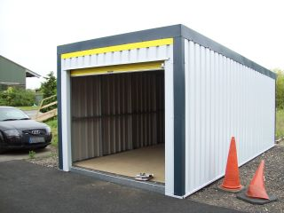 Simple box-style garage in white steel cladding