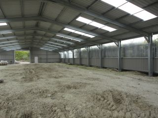 Interior of a new farm shed with plastiglass walls